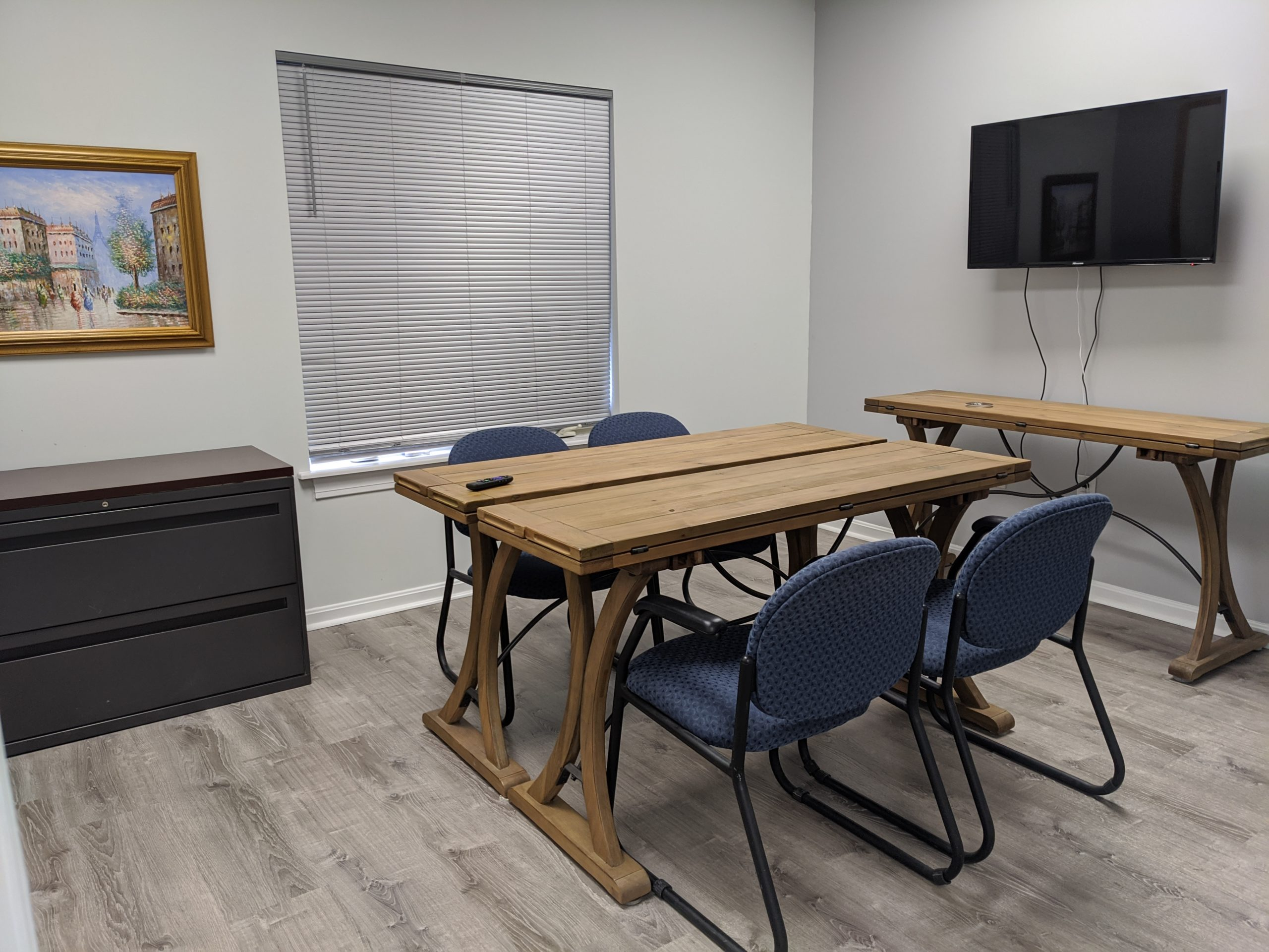 Table with Four Chairs and TV Monitor